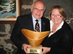 Natural edge sculpture presented by Tree Canada to MP The Hon. Royal Galipeau in recognition of his legislation establishing National Tree Day.